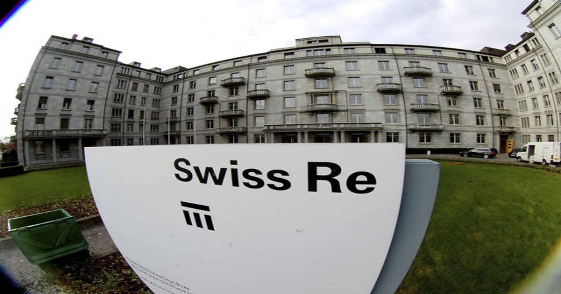 Fires, typhoons push Swiss Re's Q4 claims burden to $1.3 billion