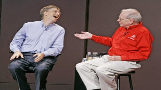 Billionaire investor Warren Buffett, right, and Microsoft Chairman Bill Gates participate in a Q & A session with students at the University of Nebraska-Lincoln's College of Business Administration, in Lincoln, Neb., Friday, Sept. 30, 2005.(AP Photo/Nati Harnik)
