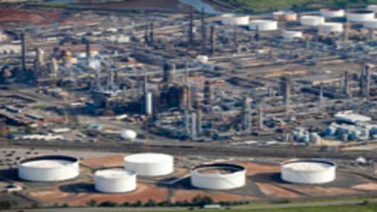 An oil refinery in Elizabeth, N.J. is shown in this aerial photo of Wednesday, Aug. 29, 2007. Oil prices extended their rise above $78 a barrel Wednesday, Sept. 12, 2007 after finishing at a record close the previous session as a production increase from OPEC failed to calm market concerns about the availability of supplies for winter in the Northern Hemisphere. (AP Photo/Mark Lennihan)