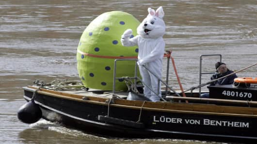 An easter bunny takes a boat tour on the river Weser in Bremen, northern Germany, with a large green papermade eastern egg Thursday, April 6, 2006. This is a promotion event for a Bremen relief organisation called Willhelm-Kaisen-Buergerhilfe, which was founded in 1945 to collect money for social affairs. (AP Photo/Joerg Sarbach)