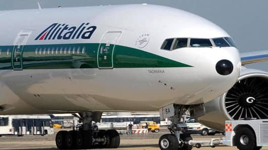 ** FILE ** An Alitalia Boeing 777 is parked at Leonardo da Vinci International Airport in Rome, in this Aug. 27, 2002 file photo. The European Union is likely to approve Italy's plan to bail out state-controlled airline Alitalia with a euros 400 million (US$488 million) bridge loan, EU Transport Commissioner Loyola de Palacio told reporters Tuesday, July 13, 2004 after meeting with Italian ministers. (AP Photo/Massimo Sambucetti/FILE)