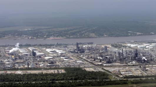 An oil refinery in Norco, La. next to the Mississippi River is seen from the window of Air Force One as President Bush approaches Louis Armstrong International Airport in Kenner, La. just outside New Orleans Thursday, April 27, 2006. He was heading to visit Hurricane Katrina rebuilding efforts in Mississippi and Louisiana (AP Photo/Gerald Herbert)