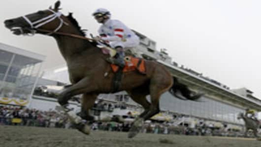 Kent Desormeaux rides Big Brown across the finish line to win 133rd Preakness horse race, Baltimore, Maryland