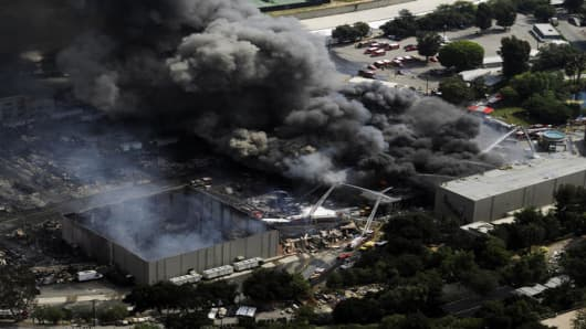 Los Angeles County and Los Angeles City firefighters battle a fire in the backlot of Universal City Studios in Universal City, Calif., north of Los Angeles Sunday, June 1, 2008. (AP Photo/Kevork Djansezian)