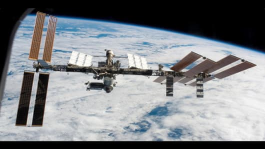 In this image provided by NASA backdropped by Earth's horizon and the blackness of space, the International Space Station is seen from Space Shuttle Endeavour as the two spacecraft begin their relative separationMonday March 24, 2008. Earlier the STS-123 and Expedition 16 crews concluded 12 days of cooperative work onboard the shuttle and station. (AP Photo/NASA)