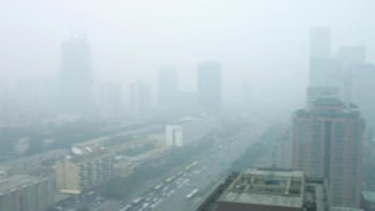 Buildings seen through thick pollution in Beijing, China.