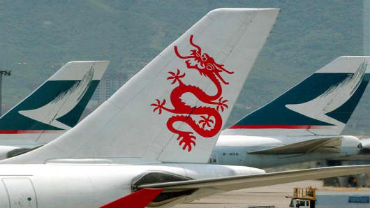 **FILE** Hong Kong's two passenger airlines, Cathay Pacific Airways and Dragonair, are seen near each other on the runway in Hong Kong in this April 17, 2003 file photo. Cathay Pacific Airways Ltd. and Hong Kong Dragon Airlines Ltd. will likely wrap up talks Thursday June 8, 2006 about Cathay's bid to take over the smaller carrier that has highly coveted routes to the booming mainland Chinese market, a person familiar with the negotiations said. (AP Photo/Anat Givon)