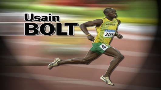 Jamaica's Usain Bolt passes by the scoreboard as he sets a new world record to win the gold medal in the men's 100-meter final during the athletics competitions in the National Stadium at the Beijing 2008 Olympics in Beijing, Saturday, Aug. 16, 2008. (AP Photo/Ricardo Mazalan)