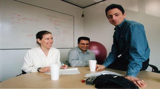 Susan Wojcicki, Omid Kordestani, and Sergey in the office in Palo Alto.