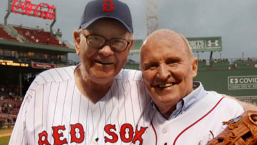 Warren Buffett and Jack Welch on the field at Fenway Park in Boston