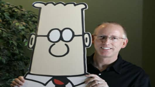 Scott Adams poses with a two-dimensional Dilbert in this 2006 file photograph.