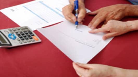 signing_loans.jpg
