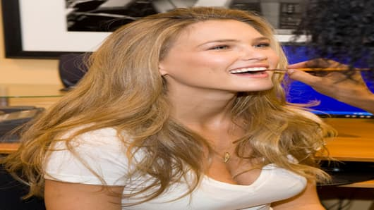 Cover model Bar Refaeli gets ready in the CNBC green room.
