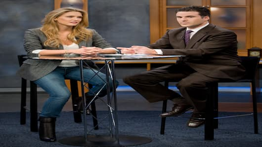 Bar Refaeli and Darren Rovell get camera direction on the CNBC set.