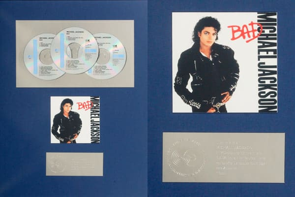 Groups of awards presented to Michael Jackson for the sale of more than 1.5 million copies of the album , 1.5 million copies of the album  (shown), 2 million copies of the album , 1.5 million copies of the album and 2 million copies of the album sold in Germany. Estimated Value: $400 - $600