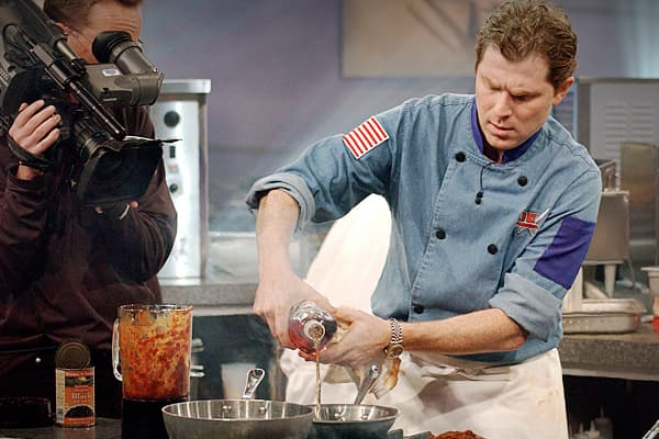Bobby Flay is an American born celebrity chef. He owns 7 restaurants around the US. He's put out his own line of cooking sauces and rubs, and has a new kitchen product line through Kohl's. He is one of four chefs that regularly appear on the hit television show Iron Chef and it's rumored that his net worth is somewhere around $20 million.