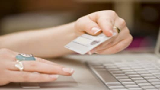 Online shopping with a credit card.
