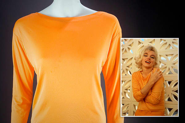 "Estimated Auction Value: $7,000 – $9,000Sherbert orange long-sleeved boat neck Pucci blouse of silk jersey, size 12, label reads, ""Emilio Pucci/ Florence Italy"" and ""Made in Italy exclusively for Saks Fifth Avenue."""