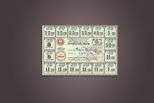 """We normally think of money as fully fungible, meaning it is interchangeable for like value of all goods and services. But this is by no means universal. In some cultures, certain currencies can only purchase certain things, such as a bride or raw land. This Vietnamese bill is one such example. It operated like the old Green Stamp coupon book. """"Around the edges are a bunch of perforated coupons that you would tear off to buy pieces of clothing; you would tear one off for a shirt or a pair of pant"""