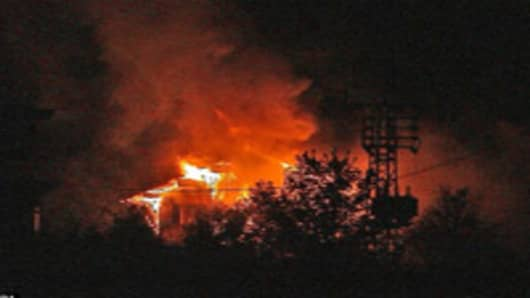 Vasella home in flames.