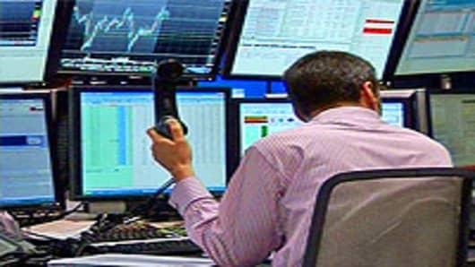Trader at London Stock Exchange, England.