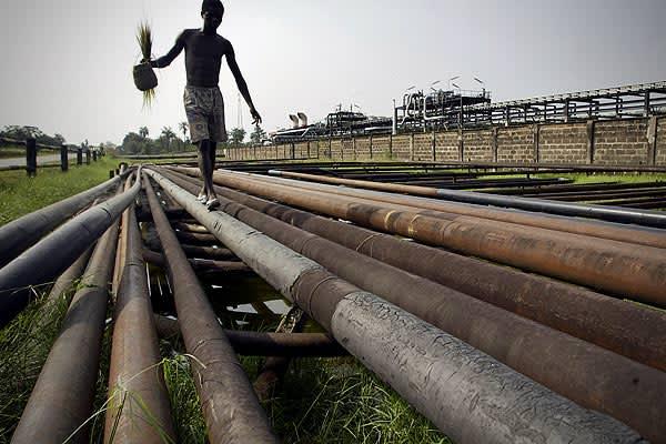 Proved Oil Reserves: 36.2 billion barrelsTotal Oil Production: 2.168 million barrelsCrude Oil Production: 2.165 million barrelsConsumption: 286,000 barrelsExports to US (2007): 1.13 million barrelsPictured: Boy walks along oil pipeline belonging to the Agip Oil company in Idu Ogba, Niger Delta area of Nigeria.
