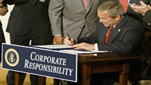 George W. Bush signs bill on corporate responsibility