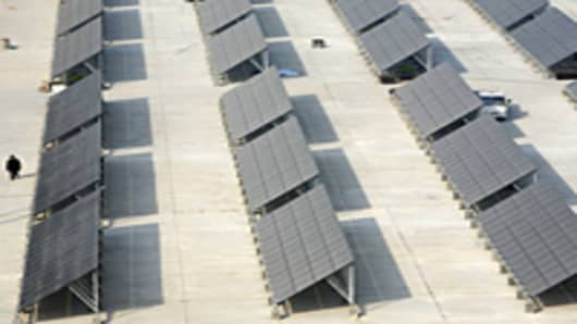 Solar panels at a solar photovoltaic power station under construction in Xining of Qinghai Province, China.