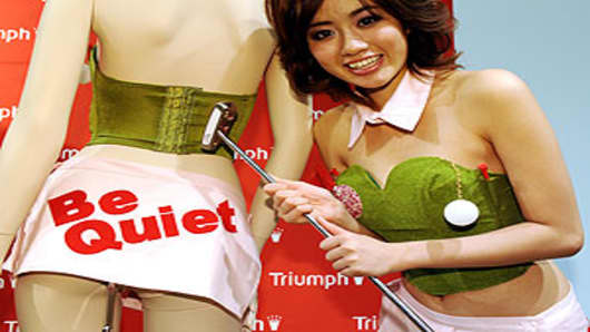 Reiko Aoyama, the campaign girl for Japan's lingerie maker Triumph International Japan, wears a 'make-the-putt bra'.