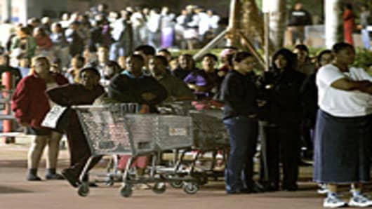 People stand in front of a Walmart store before the doors open at 5am on 'Black Friday' in Miami, Florida.