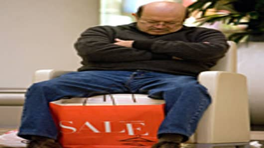 A man takes a break as he joins the crowds taking advantage of the post-Christmas sales in San Francisco, California.