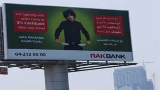 Billboard advertisement for RAK Bank in Dubai.