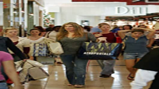 Shoppers make their way through Baybrook Mall in Friendswood, Texas.