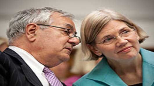Rep. Barney Frank (D-MA), chairman of the House Financial Services Committee (L), talks with Elizabeth Warren, Chair of the TARP Congressional Oversight Panel
