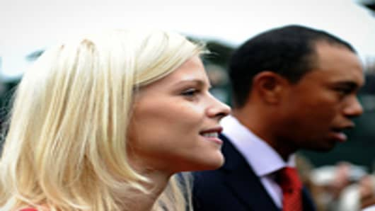 Elin Nordegren and husband Tiger Woods exit during Opening Ceremony of The Presidents Cup at Harding Park Golf Course on October 7, 2009 in San Francisco, California.