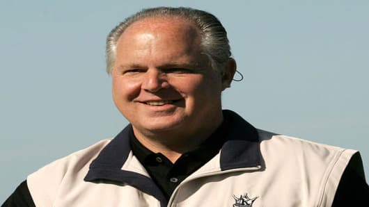 Rush Limbaugh smiles after teeing off on the fourth hole of the Spyglass Hill Golf Course during the first round of the AT&T Pebble Beach National Pro-Am in Pebble Beach, Calif., Thursday Feb. 10, 2005. (AP Photo/Jeff Chiu)
