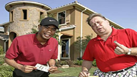 Tiger Woods impersonator Canh Oxelson with a Rodney Dangerfield impersonator.