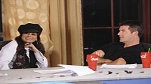 Simon Cowell and Paula Abdul