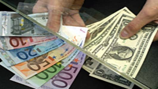 Euro bills and U.S. dollars being exchanged