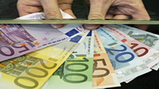 Euro bills at teller window