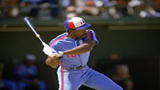 Andre Dawson while with the Montreal Expos swings during a 1986 season game against the San Diego Padres at Jack Murphy Stadium in San Diego, California.