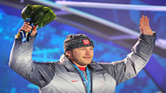 USA's bronze medallist Bode Miller celebrates during the medal ceremony for the Men's Alpine skiing downhill event.