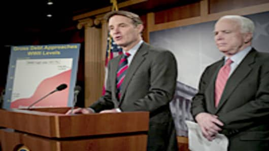 Sen. Evan Bayh and Sen. John McCain during a news conference on their bill aimed at reining in government spending and to address the national debt.