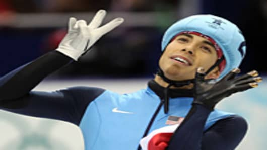 Apolo Anton Ohno of the United States celebrates winning the bronze medal for the men's 1000 m short track speed skating at the Vancouver 2010 Winter Olympics.