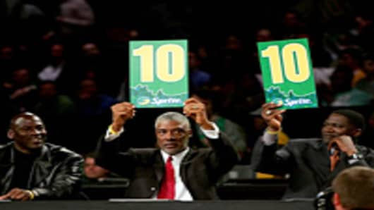 Judges Michael Jordan, Julius Erving and Dominique Wilkins hold up the scores for the winning dunk by Gerald Green of the Boston Celtics in the Sprite Slam Dunk Competition during NBA All-Star Weekend in Las Vegas, Nevada.