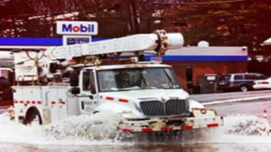 A utility truck drives through flood water, Greenburgh, New York on March 14, 2010.