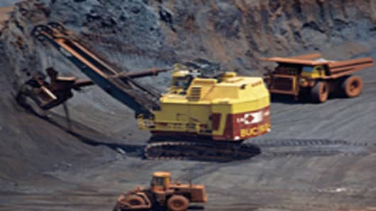 Open cast mining for iron ore.