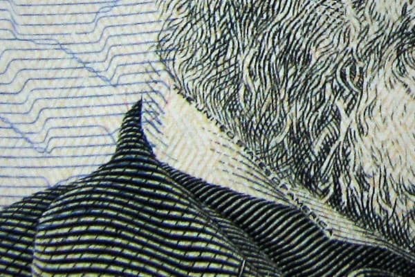 """Microprinting also can be found around the portrait as well. Note """"The United States of America"""" printed on Grant's collar on the $50 bill."""