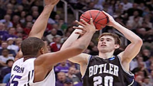 Gordon Hayward #20 of the Butler Bulldogs puts up a shot over Luis Colon #15 of the Kansas State Wildcats during the west regional final of the 2010 NCAA men's basketball tournament.