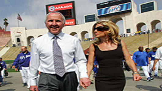Los Angeles Dodgers owner Frank McCourt (L) and Jamie McCourt walk into the Memorial Coliseum prior to the start of the game against the Boston Red Sox March 29, 2008 in Los Angeles, California.